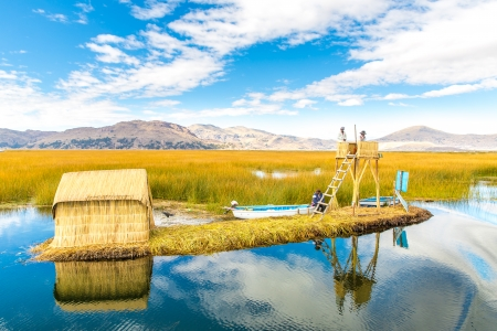 lake dwelling:  Floating  Islands on Lake Titicaca Puno, Peru, South America, thatched home. Dense root that plants Khili interweave form natural layer about one to two meters thick that support islands