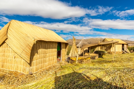 lake dwelling: Thatched home on Floating  Islands on Lake Titicaca Puno, Peru, South America  Dense root that plants Khili interweave form natural layer about one to two meters thick that support islands