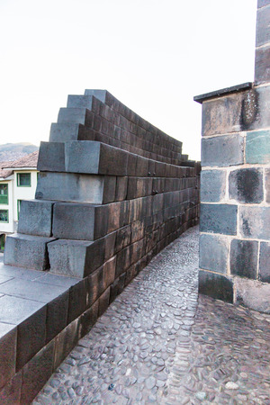 Inca Wall in ancient city of Coricancha Temple, Cusco,Peru, South America  Example of  polygonal masonry  and skill photo