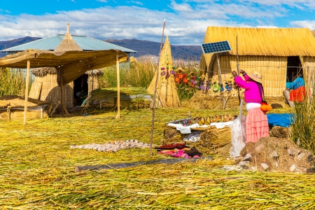 lake dwelling:  Floating  Islands on Lake Titicaca Puno, Peru, South America Stock Photo