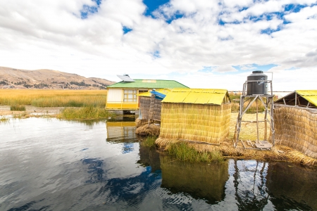lake dwelling: Floating  Islands on Lake Titicaca Puno, Peru, South America. Dense root that plants Khili interweave form natural layer about one to two meters thick that support islands