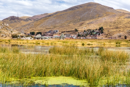 commercially: Lake Titicaca,South America, located on border of Peru and Bolivia. It sits 3,812 m above sea level, making it one of the highest commercially navigable lakes in the world.
