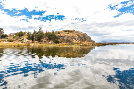 commercially: Lake Titicaca,South America, located on border of Peru and Bolivia  It sits 3,812 m above sea level, making it one of the highest commercially navigable lakes in the world  Stock Photo