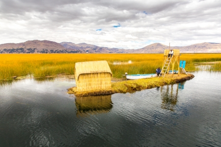 lake dwelling: Floating Islands on Lake Titicaca Puno, Peru, South America, thatched home  Dense root that plants Khili interweave form natural layer about one to two meters thick that support islands