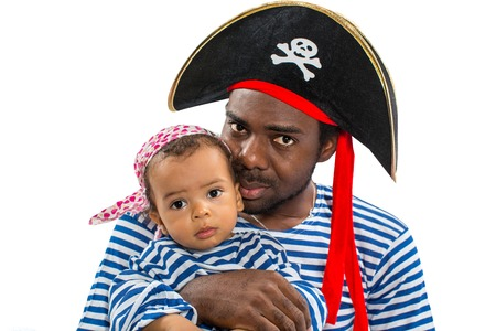 African american child boy and father in costume pirate on white background  Baby Halloween Fancy Costume and holiday
