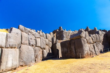 peru architecture: Inca Wall in SAQSAYWAMAN, Peru, South America  Example of polygonal masonry  The famous 32 angles stone in ancient Inca architecture  Stock Photo
