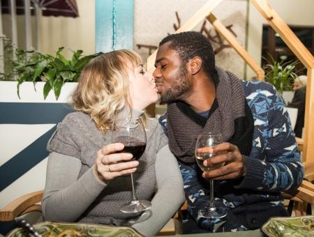 Black man and white woman kissing
