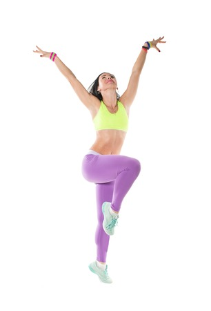 zumba: Young woman dancing isolated on white Happy cheerful  female enjoying fitness dance