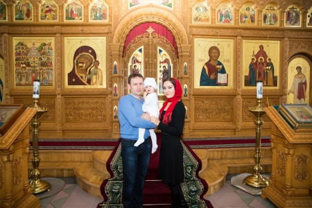 Christening  Family celebrating  baptism in Orthodox Church of baby girl