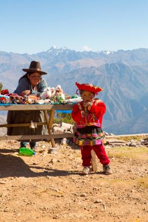 incan: Souvenir market on street of Ollantaytambo,Peru,South America. Colorful blanket, cap, scarf, cloth, ponchos from  wool of alpaca, llama