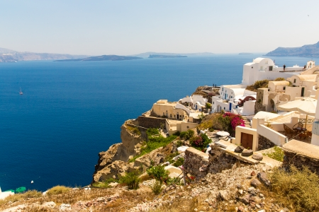 fira: View of Fira town - Santorini island,Crete,Greece. White concrete staircases leading down to beautiful bay with clear blue sky and sea