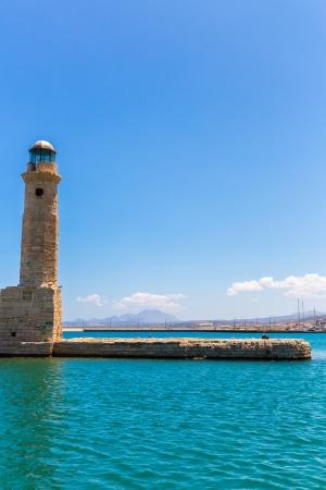 Old venetian lighthouse at harbor. Rethymno, Crete, Greece photo