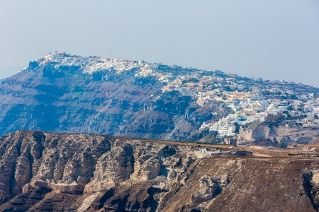 staircases: View of Fira town - Santorini island,Crete,Greece. Beautiful bay with clear blue sky and sea