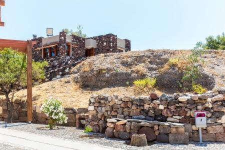 fira: Santorini island,Crete,Greece. Ruins and archaeological site in Fira town Stock Photo