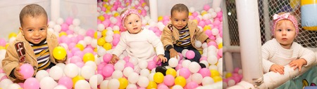 Happy children in colored ball on birthday on playground  The concept of childhood and holiday photo