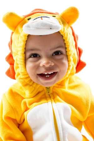 Black child boy,dressed in lion carnival suit, isolated on white background  Baby zodiac - sign Leo  The concept of childhood and holiday