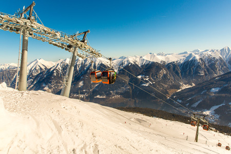 Cableway and chairlift in ski resort Bad Gastein in mountains, Austria. Austrian alps - nature and sport background photo