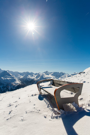 Bench in ski resort Bad Gastein in winter snowy mountains, Austria, Land Salzburg,  Austrian alps - nature and sport background photo