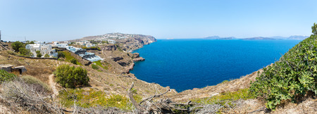 Panorama of Fira town - Santorini island,Crete,Greece  White concrete staircases leading down to beautiful bay with clear blue sky and sea