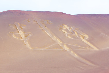 Candelabra, Peru, ancient mysterious drawing in the desert sand, Paracas National Park photo
