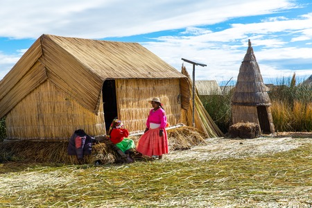 interweave: Floating Islands on Lake Titicaca Puno, Peru, South America, thatched home. Dense root that plants Khili interweave form natural layer about one to two meters thick that support islands