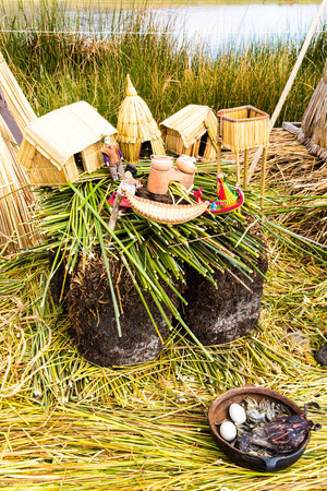 Floating Islands on Lake Titicaca Puno, Peru, South America, thatched home. Dense root that plants Khili interweave form natural layer about one to two meters thick that support islands photo