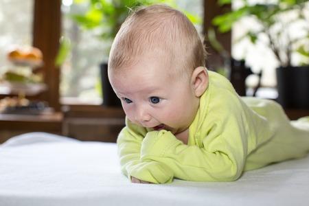 Cute newborn baby girl at home