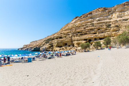 limestone caves: Pebbly beach Matala, Greece Crete. Matala has become famous for artificial  Neolithic caves, carved in limestone rocks. During the 70s the caves were hosting an international hippie community