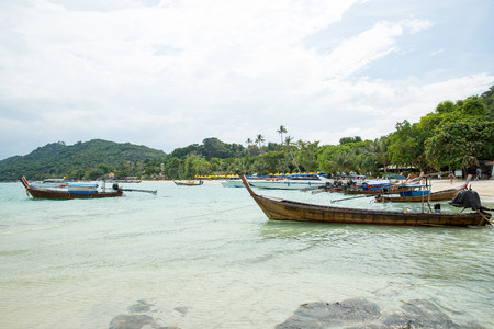 phi phi: Traditional longtail boat in bay on Phi Phi Island, Krabi,Thailand beach, Phuket