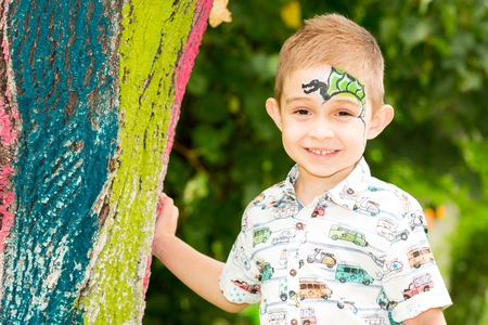 Cute little child boy with akvagrim in park on nature at summer. Use it for baby, parenting or love conce