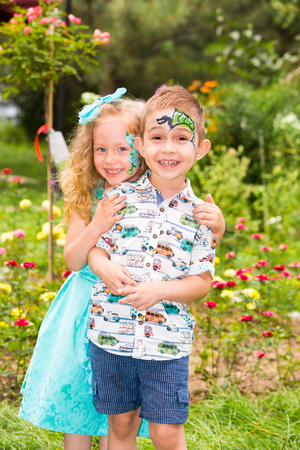 The boy and girl child with aqua make-up on happy birthday. Celebration concept and childhood, love