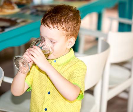 Portrait of boy kid drinking glass of water