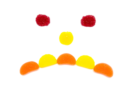 fruit jelly: the smiling fruit jelly isolated on white