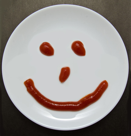 A smiling plate on a dark background