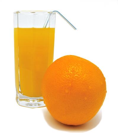Glass of orange juice with yellow orange and tubule isolated on white background