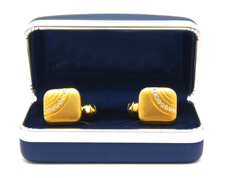 Vintage gold cufflinks with crystals in box isolated on white background