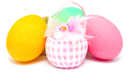 Colorful handmade decorated Easter eggs in a nest