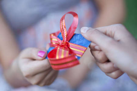 sharpness: Credit card with a bow in a gift to the young woman. Small depth of sharpness. Business style Stock Photo