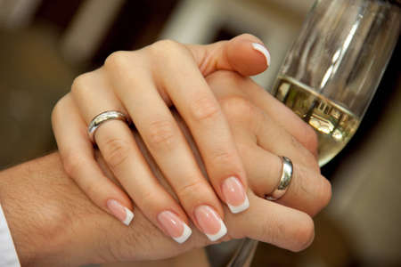 groom holding a glass. bride groom holding hands photo