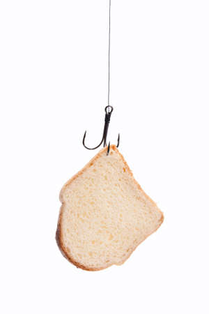analog�a: pieza de pan blanco colgado en un anzuelo. aislado