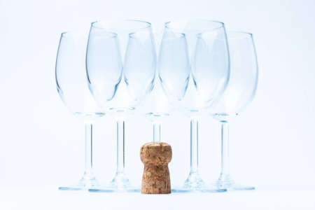 glass wine stand symmetrically with cork photo