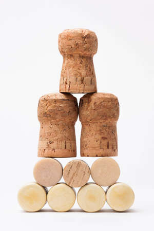 Pyramid made of bottle cork stoppers on white Stock Photo - 12928407