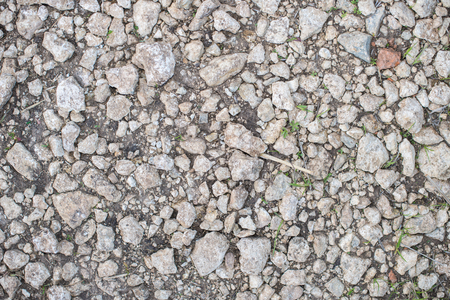 Background stones, gravel texture, road background of a country road.