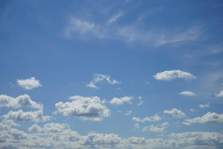 Cumulus clouds in a blue sky.
