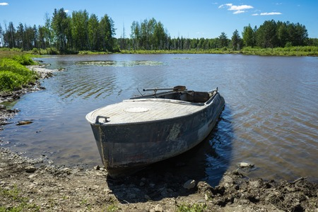 Boat on river at beautiful summer day.