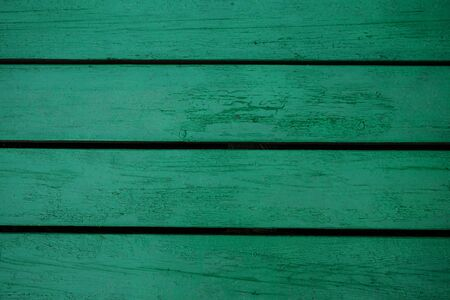 The background of the old painted green boards