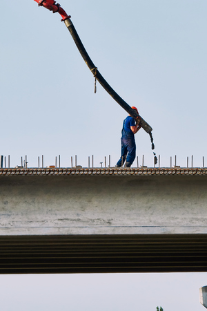concrete pump: Road works on the construction of the bridge