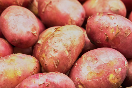 detail of bunch: Pink new potatoes on the market close up Stock Photo
