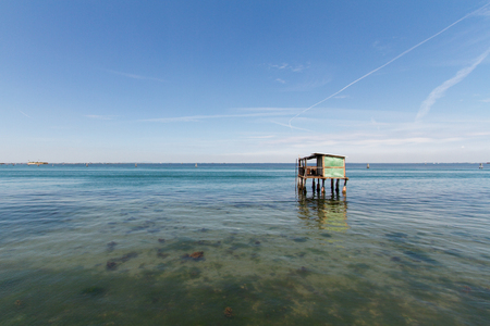 Fisherman house in Pellestrina, an island of the venetian lagoon, alone in the lagoon