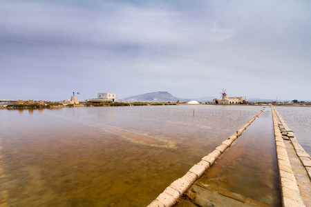 Historical saltworks in Trapani. The salt cultures, extraction and production in this city Represents one of the major economic and revenue is one of the oldest traditions